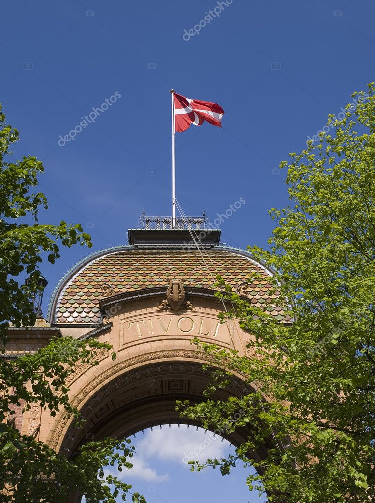 Denmark flag waving in the Tivoli Gardens, Copenhagen, Denmark — Stock Photo #9724482