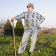Stock Photo: Farmer posing with his line of tillage