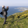 Stock Photo: Man photographing a landscape