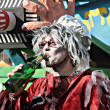 Zombie drinking a beer - Stock Photo