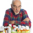 Stock Photo: Senior mand medicine bottles