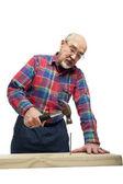 Senior man with hammer — Stock Photo
