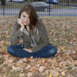Young woman in the leaves — Stock Photo #9791993