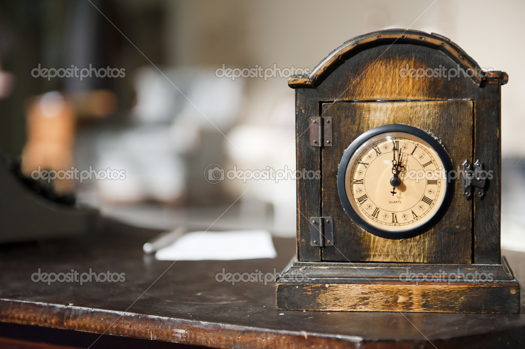 Antique Clock on antique desk with narrow focus on the clock — Stock Photo #9791924