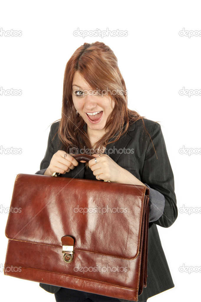 Young woman excitedly holds up her leather briefcase  Stock Photo #9791962