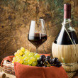 Grapes, bottle and a glass of wine — Stock Photo