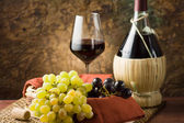 Grapes, bottle & glass of wine — Stock Photo
