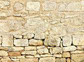 Used background of stone wall — Stock Photo