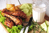 Roasted chicken legs — Stok fotoğraf