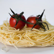 Pasta and two tomatoes — Stock Photo