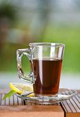 Glass of tea with lemon — Stock Photo