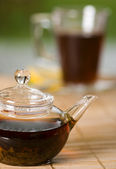 Teapot full of tea on the table — Stock Photo