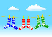 Socks on blue sky — Stock Vector
