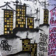 Stock Photo: Buildings on graffiti