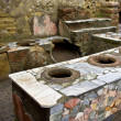 Thermopolium in Herculaneum - Stock Photo