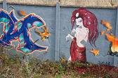 Nagie dziewczyny na graffiti — Zdjęcie stockowe