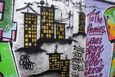 Buildings on a graffiti — Stockfoto