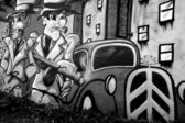 Two gangsters on a graffiti. — Stock Photo