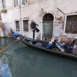 Gondolier driving a gondola — Stock Photo