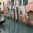 Gondola in a narrow canal in Venice — Stock Photo #9867473