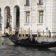 Gondolier driving a gondola with passengers — Stock Photo