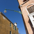 Close-up of a street lamp between two old buildings — Stock Photo