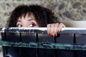 Woman is peering out of a trash container. — Stock Photo