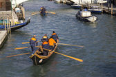 Teams of rowers training on a canal. — Stock Photo