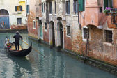 Gondola in a narrow canal in Venice — Stock Photo