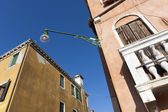 Close-up of a street lamp between two old buildings — Foto de Stock