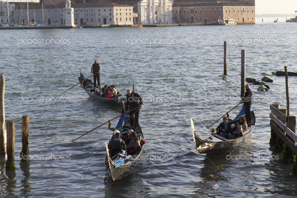 Venice, Italy - November 22, 2011:Three gondolas in the lagoon of Venice (Italy). — Stock Photo #9867515