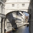 Stock Photo: Couple in love is kissing under the Bridge of Sighs