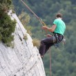Stock Photo: Descent of male rock climber