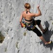 Stock Photo: Descent of a female rock climber