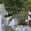 Woman praying outdoors — Stock Photo