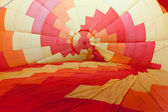 Colored hot air balloon inflating — Stock Photo