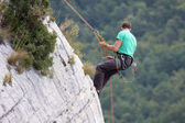 Descent of a male rock climber — Stock Photo