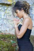 Close-up portrait of a young woman who is praying. — Stock Photo