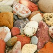 Closeup of many little stones on the beach — Stock Photo #9876024