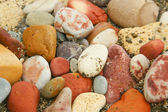 Closeup of many little stones on the beach — Stock Photo