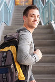 Young male college student with backpack — Stockfoto