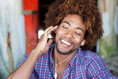 Portrait of African American listening to music — Stock Photo