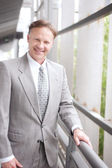 Portrait of a confident mature businessman standing outside — Stock Photo