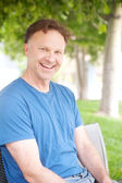 Portrait of a man in a park — Stock Photo