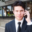Portrait of handsome, young business man using cell phone — Stock Photo