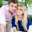 Portrait of a happy young professional couple with laptop — Stockfoto