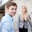 Portrait of a young professional businessman and businesswoman — Stock Photo #9881988