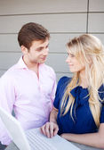 Portrait of a happy young professional couple using laptop — Stock Photo