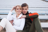 Male and female athletes sitting in the bleachers — Стоковое фото