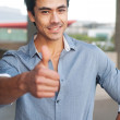 Young, handsome businessman giving thumbs up — Stock Photo #9961803